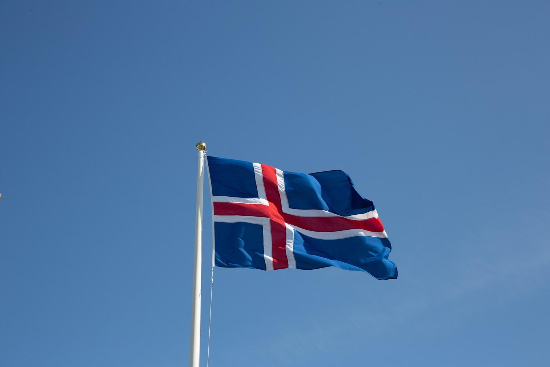 Icelandic flag against a blue sky