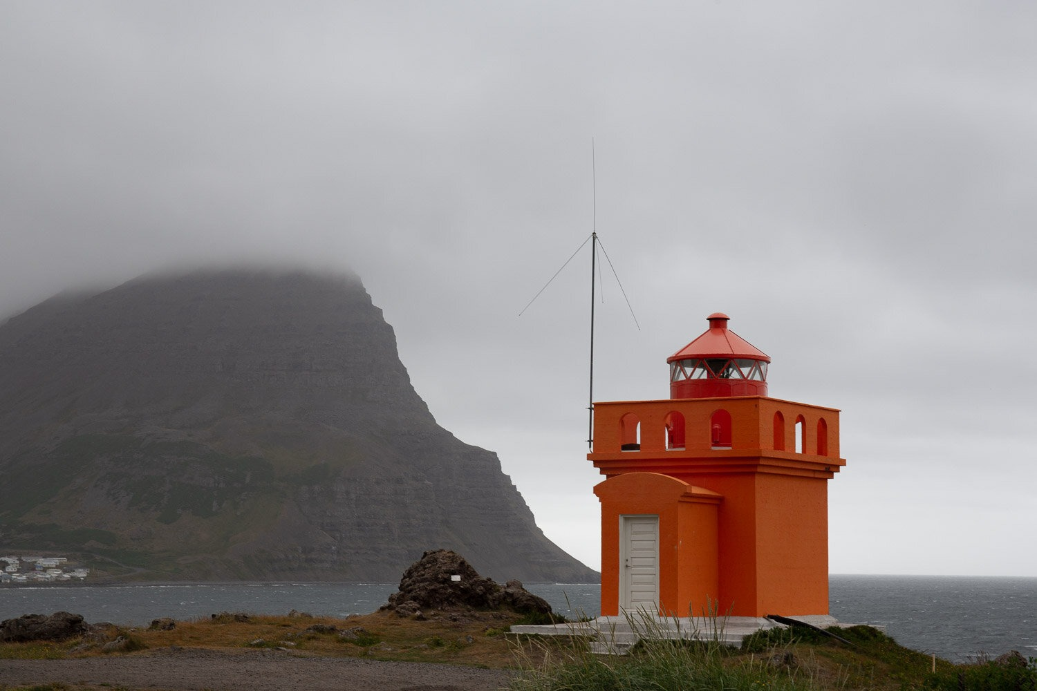 lighthouse with town behind