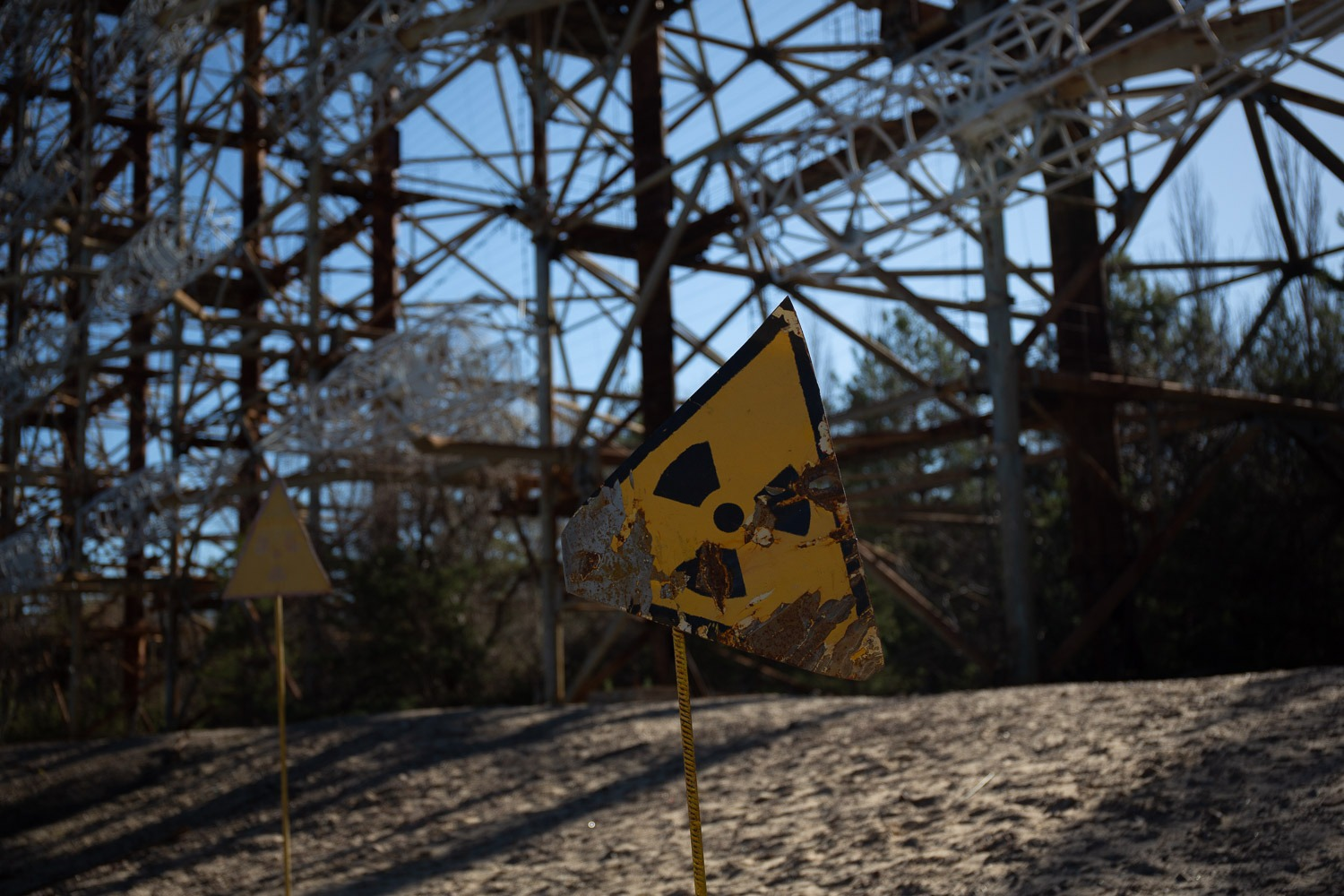 radiation sign in front of the Duga