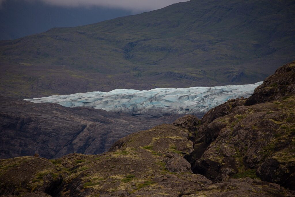 the front of a green glacier from a distance
