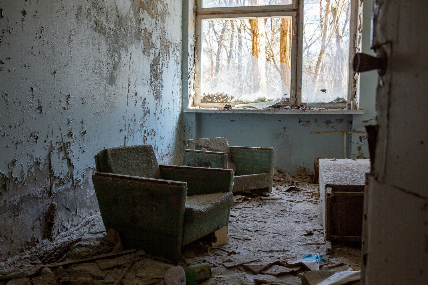 two chairs in abandoned room at Pripyat hospital