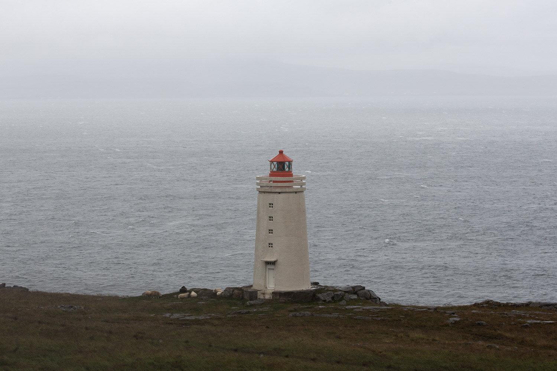 lighthouse on the coast in fog