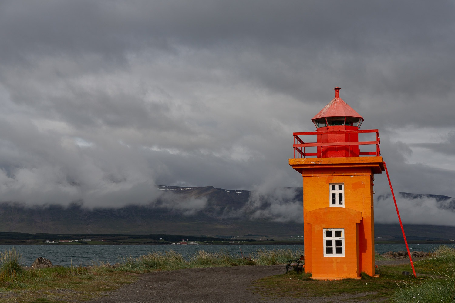lighthouse on a beach in iceland