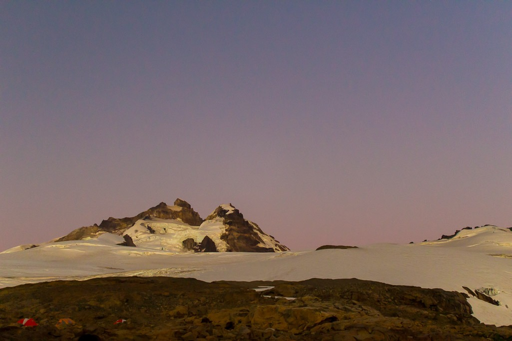 purple dawn sky with a mountain