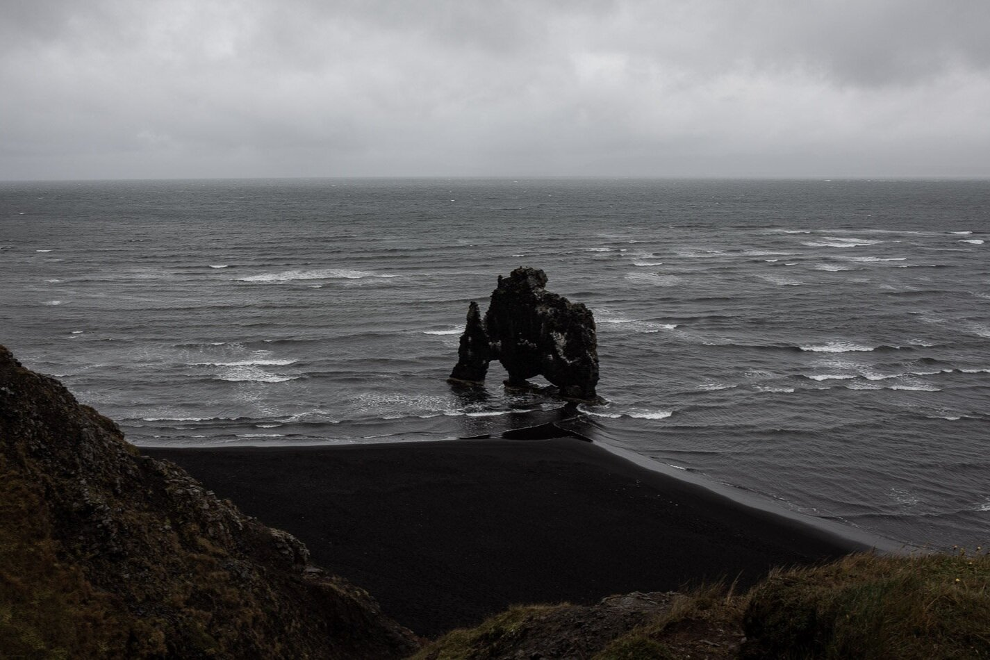 beach with black rock formation