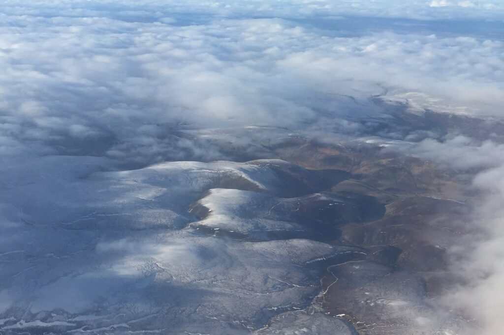 The Cairngorm mountains from above dusted in snow