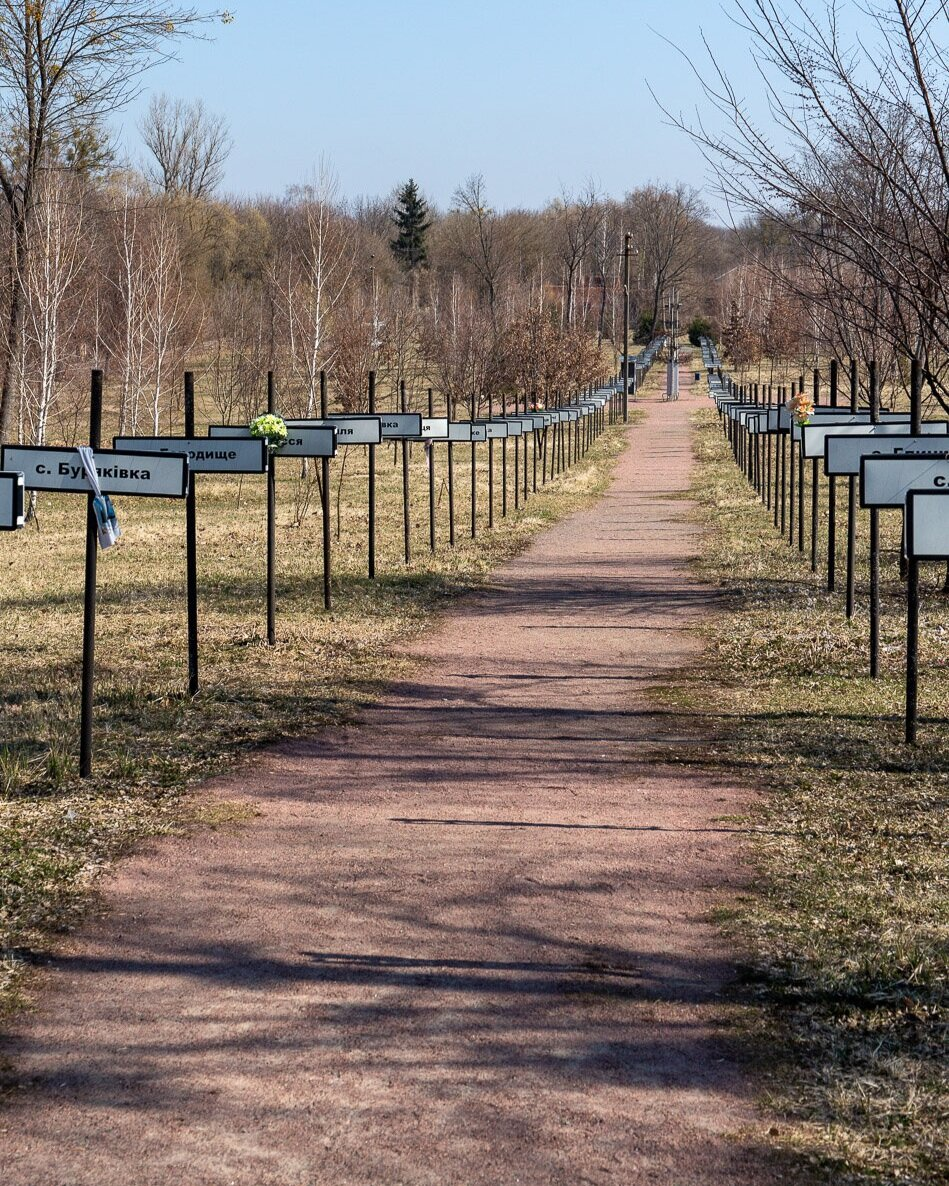 A pathway with village signs for each village lost in the Chernobyl Diisaster