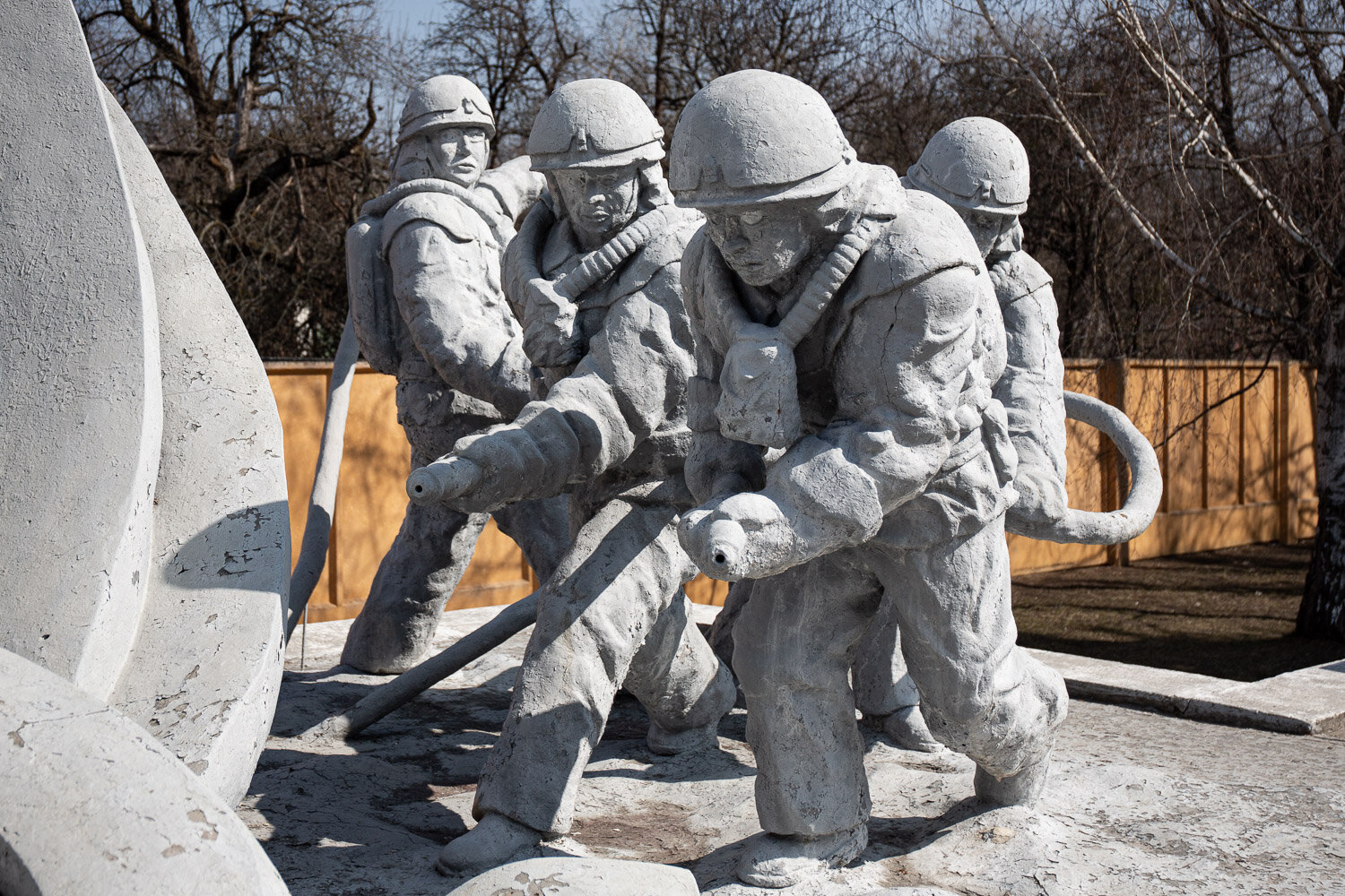 Firefighters at the monument to those who saved the world