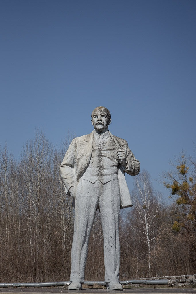 Lenin statue with blue sky behind