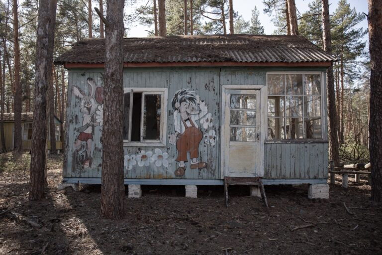 small hut in woods with cartoon characters