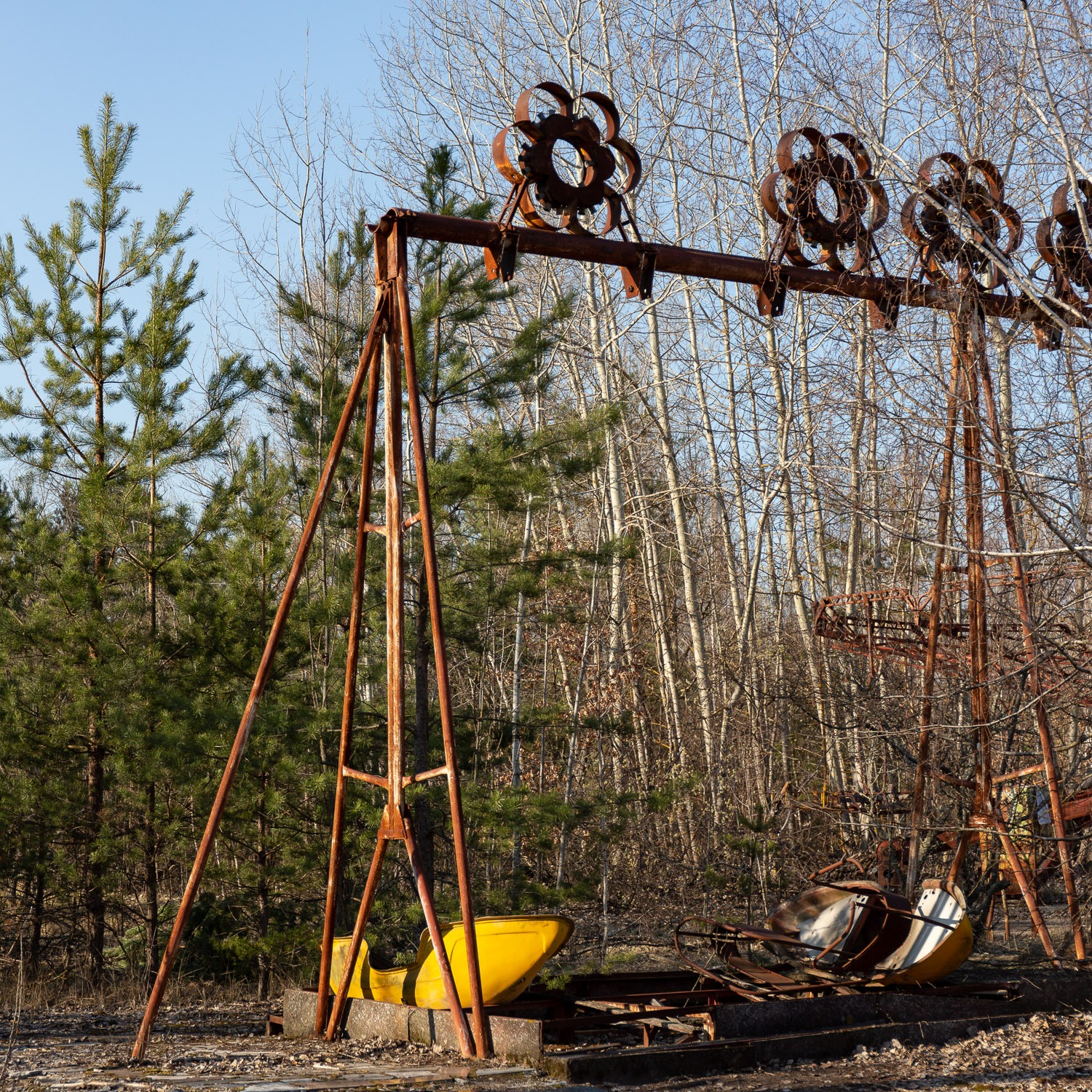 swing boats in abandoned amusement park