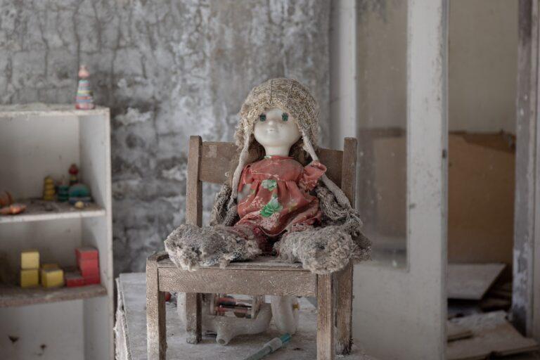 kindergarten doll on a chair