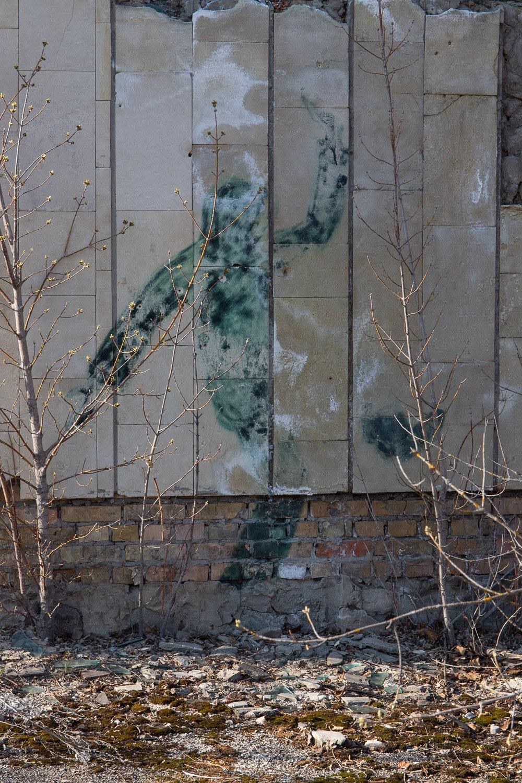 faint piece of graffiti in Pripyat city