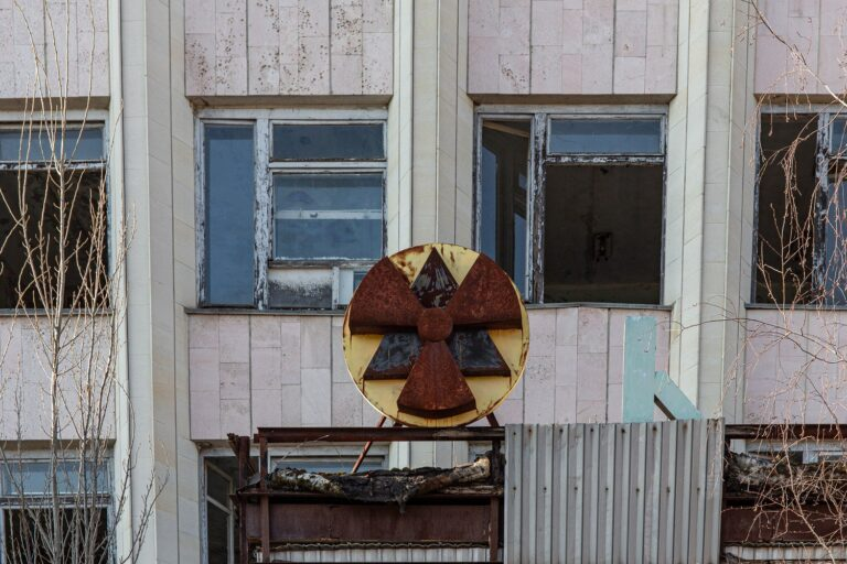 Main building in Pripyat with black and yellow radiation symbol