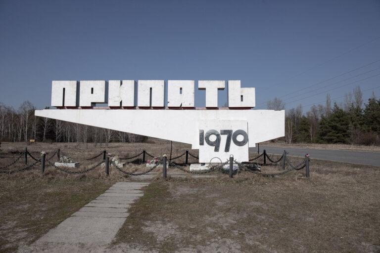 white sign for Pripyat city
