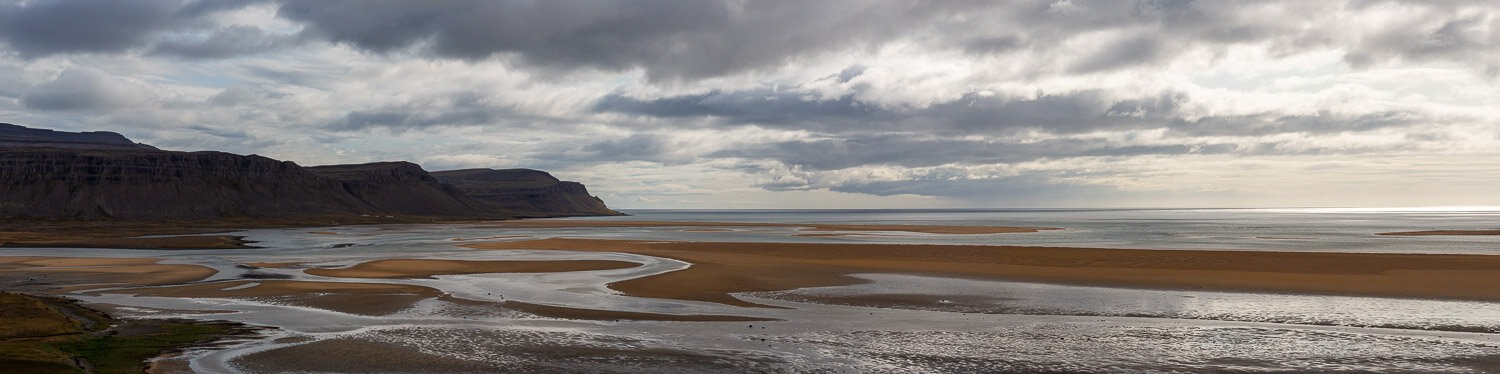 Sand patterns and river estuary at Rauðasandur Beach in Westfjords of Iceland