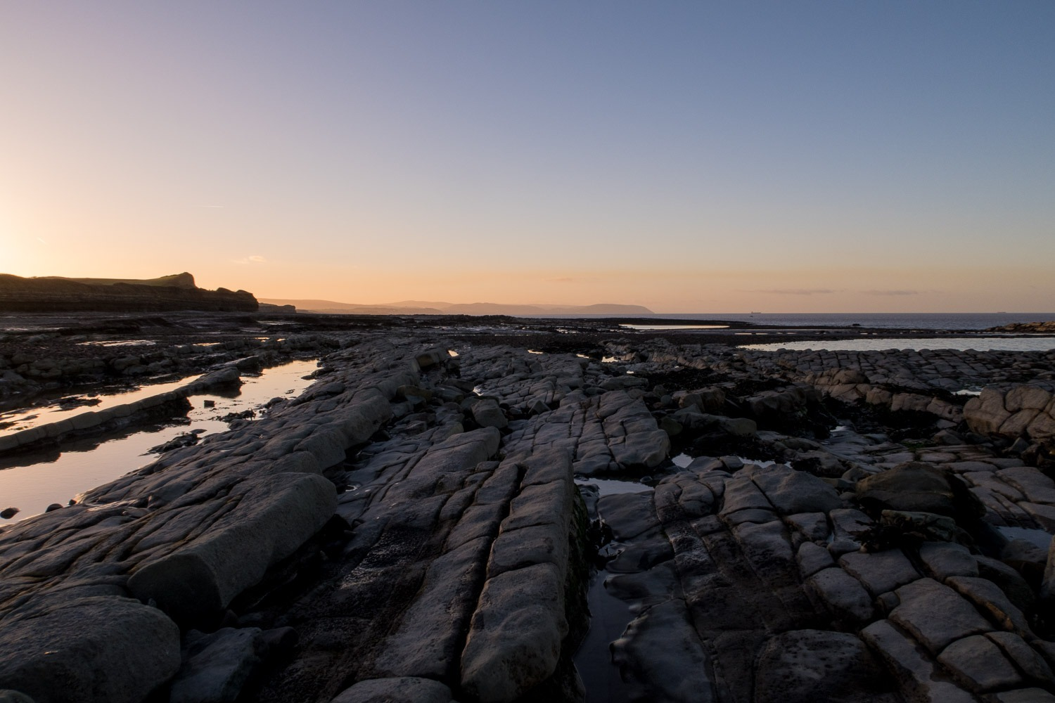 beach with rocks as leading lines