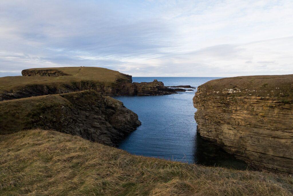 calm seas with cliffs