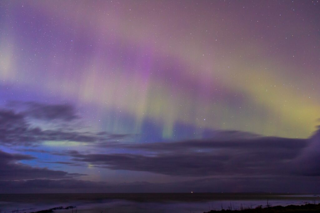 pink northern lights in the sky