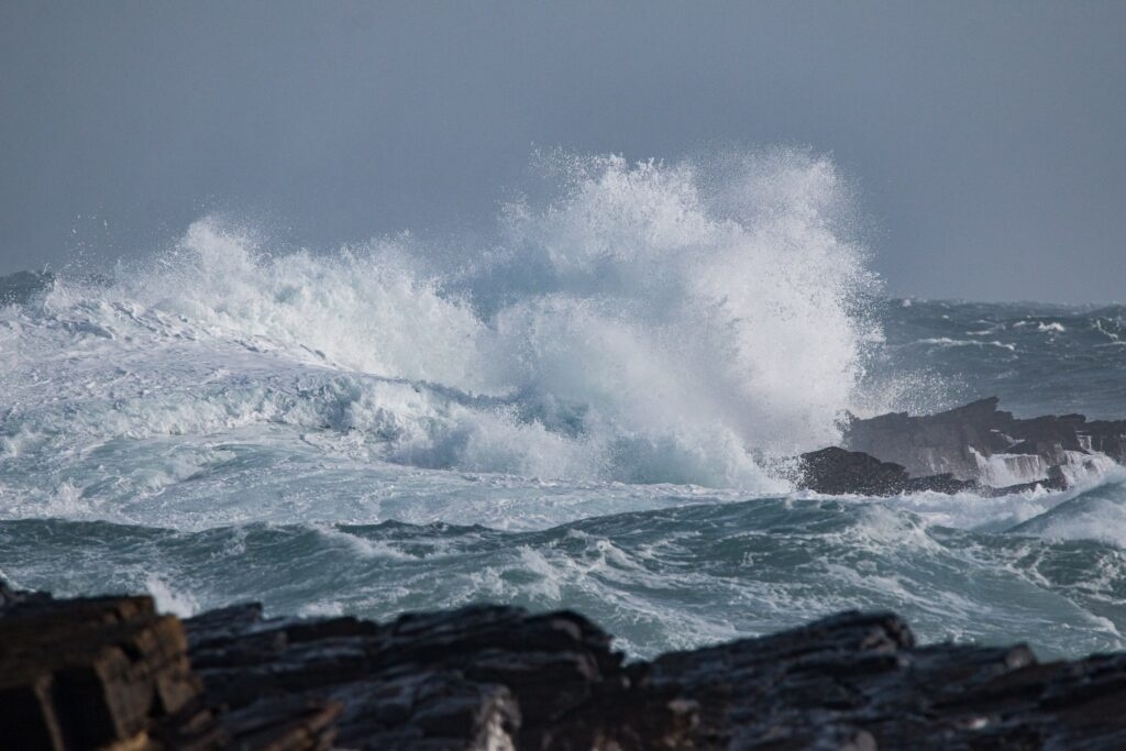 huge waves crashing on a beach