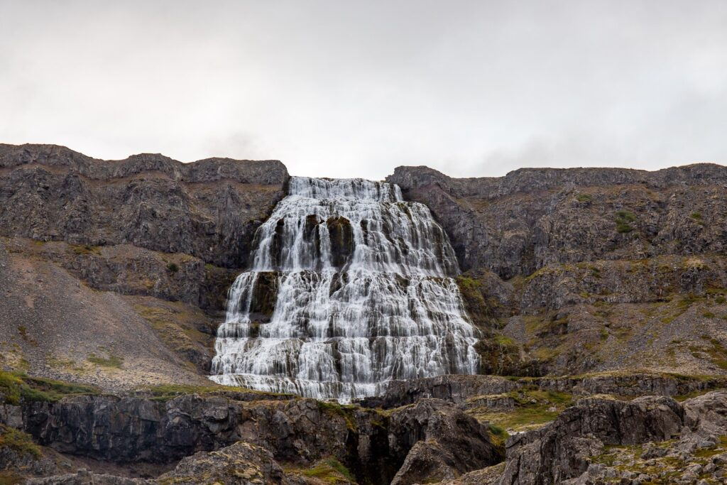 waterfall with grey sky behind