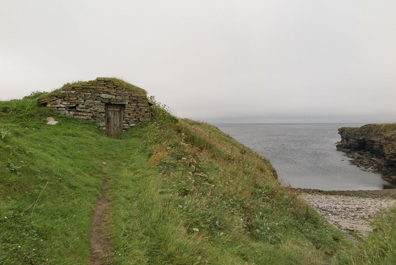 stoney beach with fishermens huts