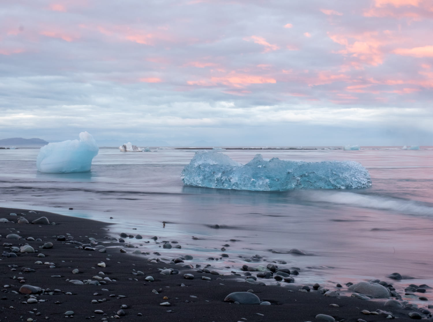 ice on diamond beach in Iceland with pink sky