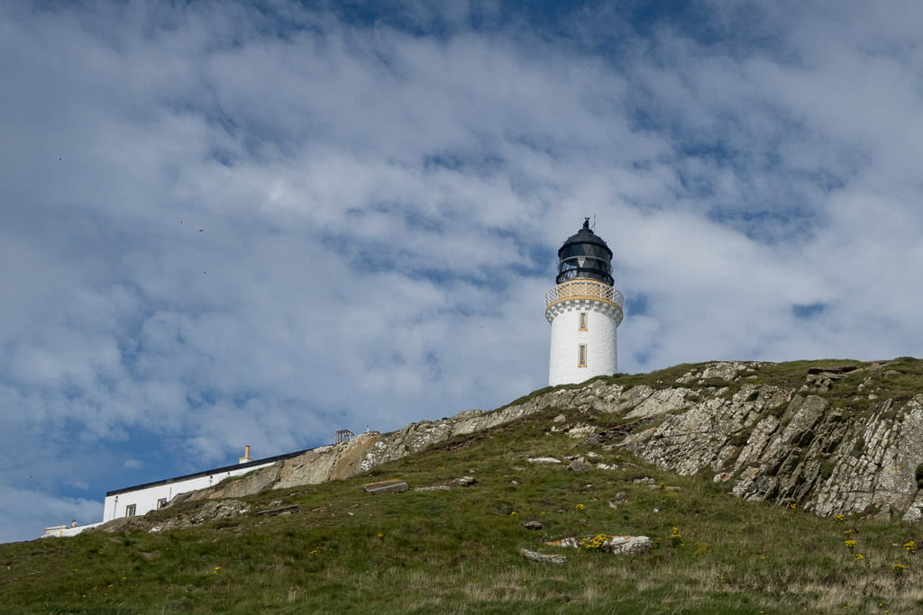 lighthouse tower with rocks