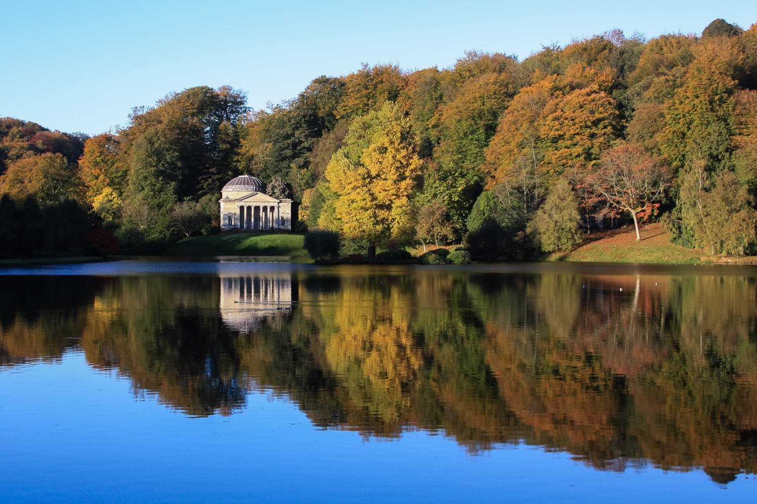 Pantheon at Stourhead Gardens with autumn leaves