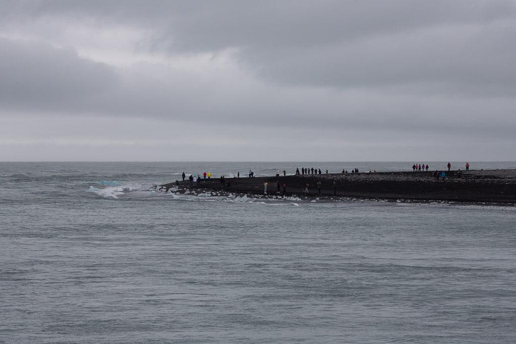 people on diamond beach in Iceland