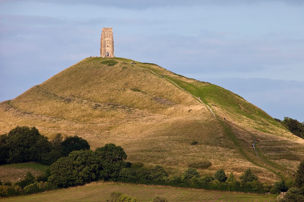 Glastonbury Tor with walkers on the hill