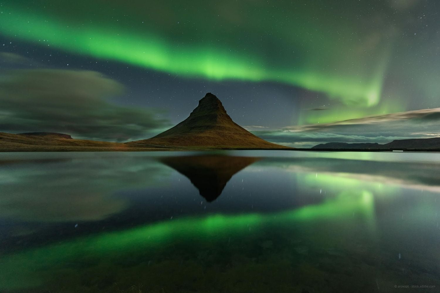 Aurora over mountain in Iceland in winter