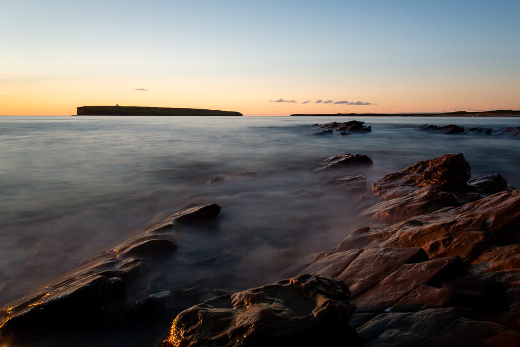 guide to the Orkney Islands at sunset