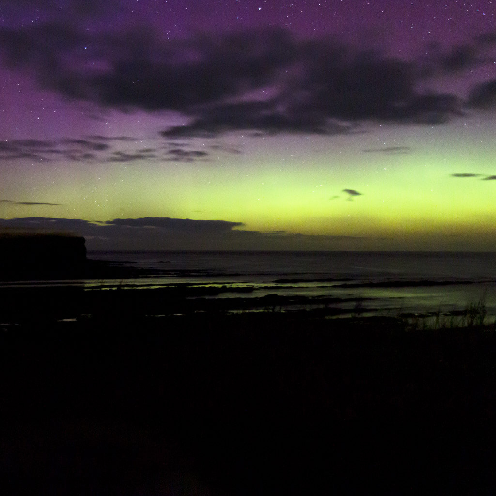 green and purple sky with sea