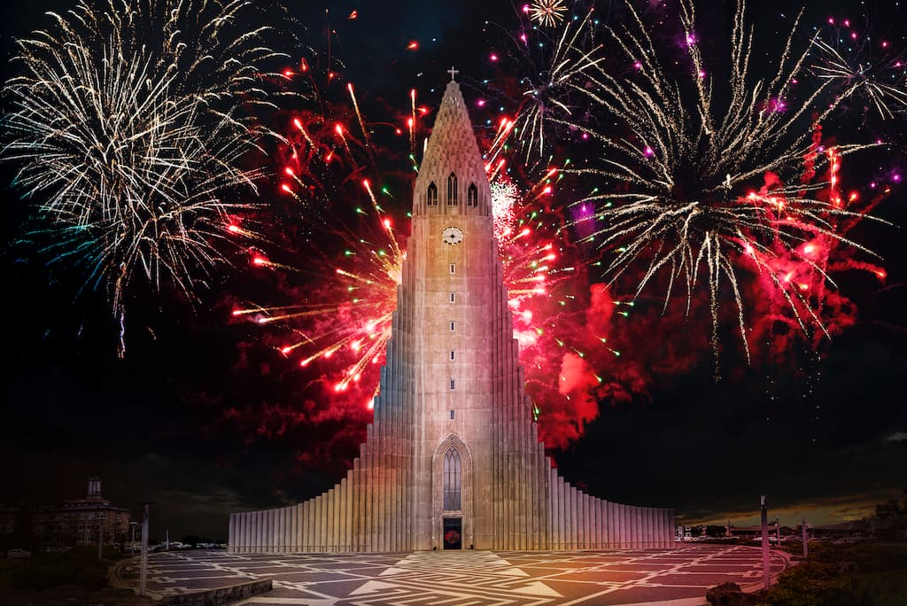 fireworks behind church for new year in Reykjavik