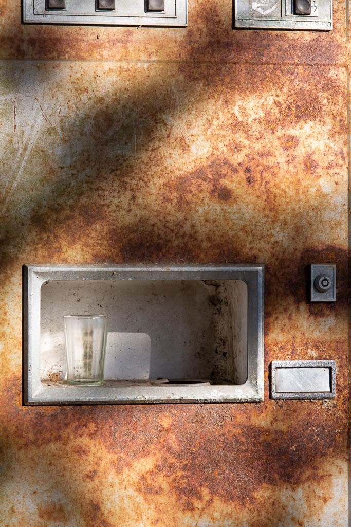 rusting vending machine with glass