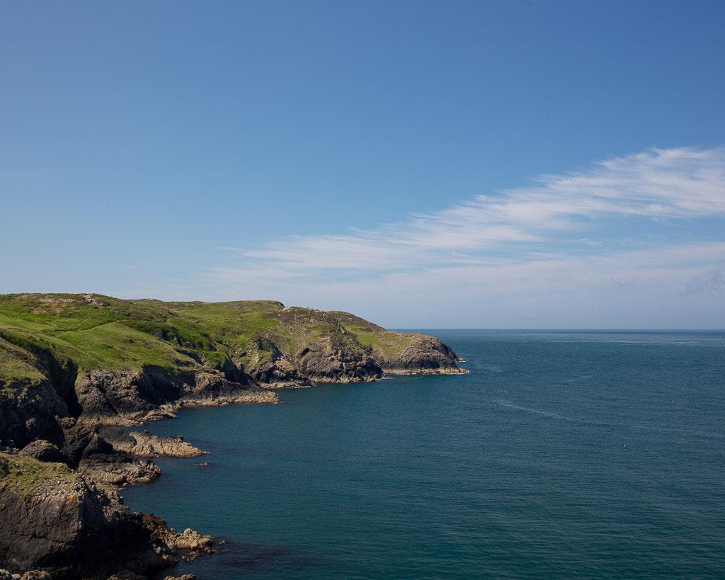 Blue sea and a green coastline