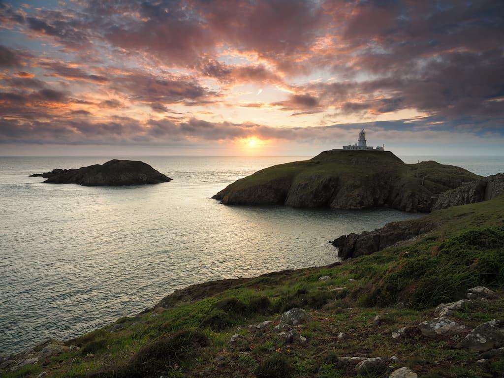 sunset over Strumble Head lighthouse